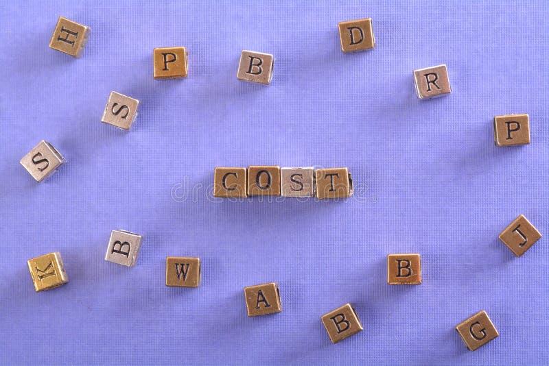 Cost word metal block stock photo