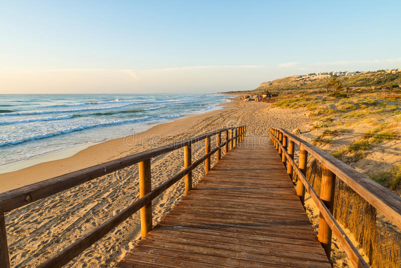 Costa Blanca beach. Wooden walkway down to a sandy beach with dunes on Costa Blanca, Alicante, Spain stock image