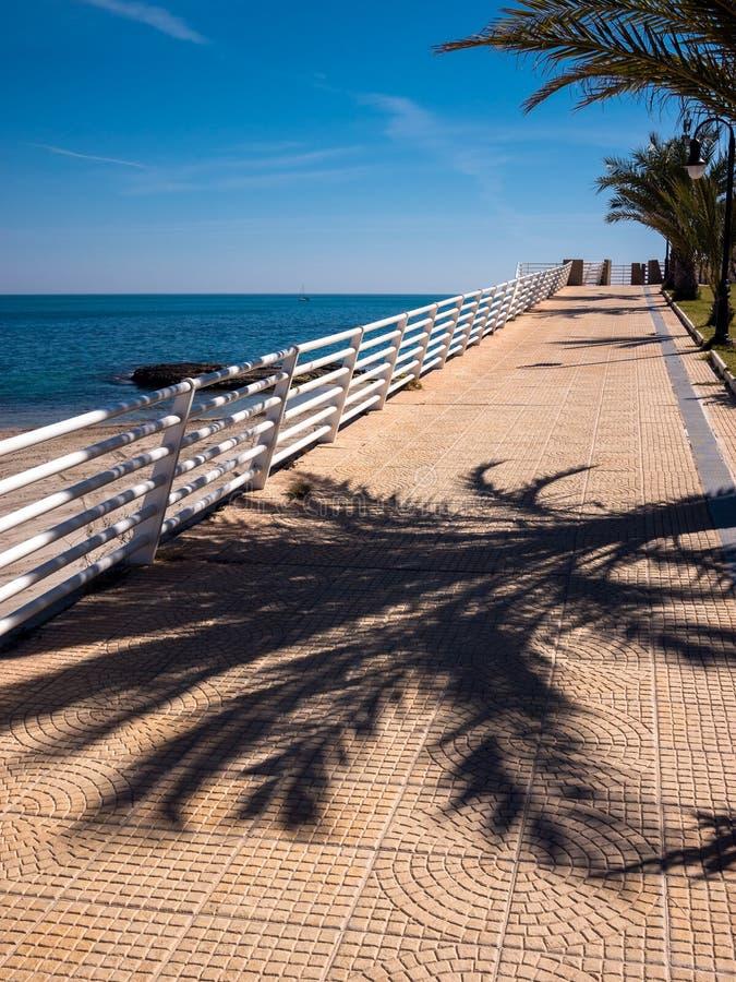 Costa Blanca Mediterranean Sea Promenade - Spain. Promenade alongside the Mediterranean sea on the Costa Blanca. Near Cabo Roig, Alicante, Spain royalty free stock images