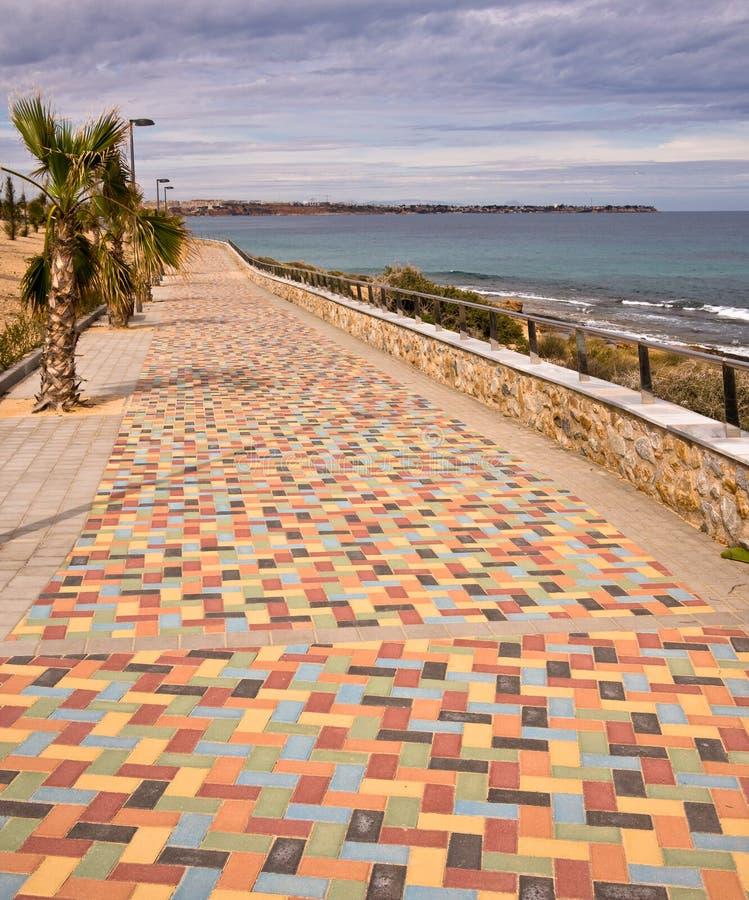 Costa Blanca Mediterranean Sea Promenade - Spain. Multi-coloured paved promenade at Mil Palmeras on the Costa Blanca. Alicante, Spain royalty free stock photography