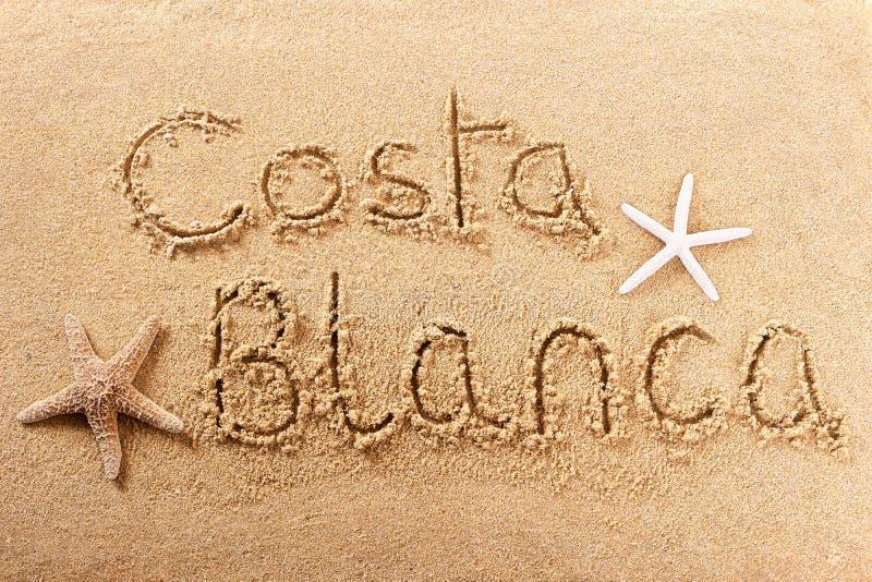 Costa Blanca Spain beach sand sign. Costa Blanca Spain beach word travel writing concept royalty free stock image