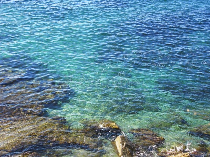 Costa Brava clear blue waters stock photo