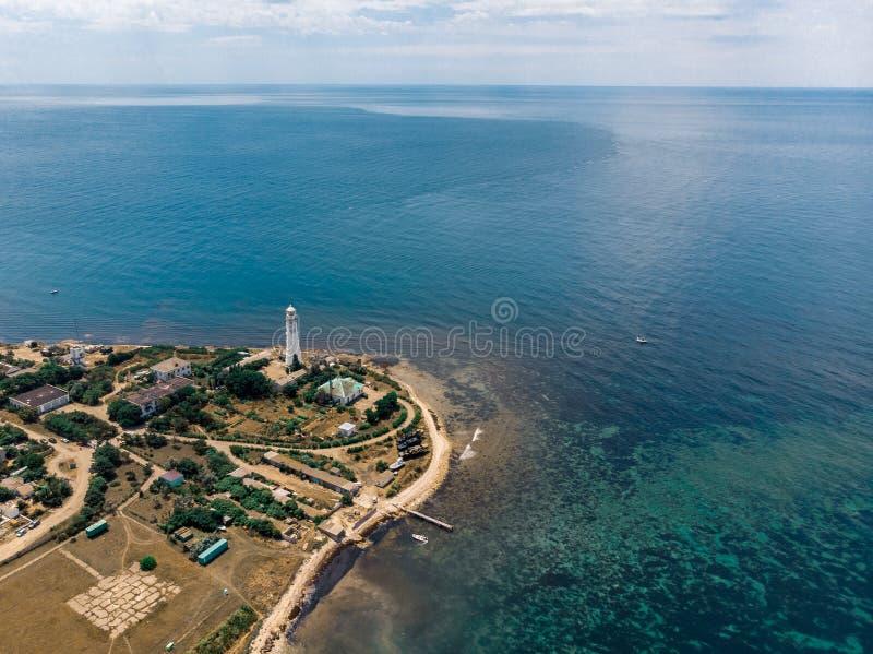 Costa com um farol no Mar Negro crimeia fotografia de stock royalty free
