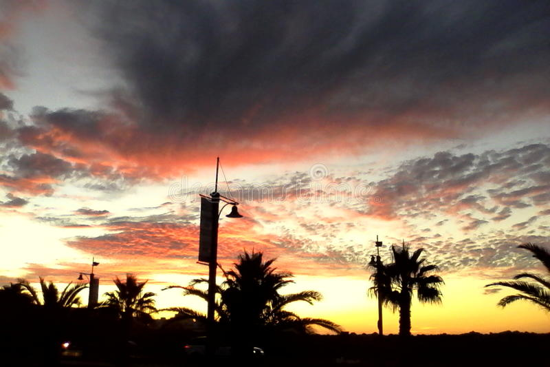 Costa de la puesta del sol fotos de archivo