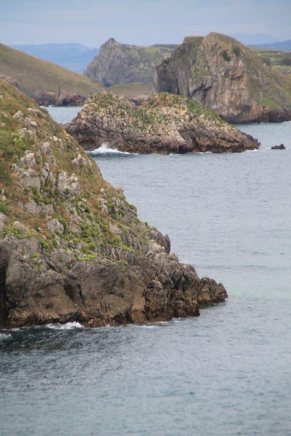 Costa de Llanes,Asturias ( Spain ). Coast of Llanes between the peninsula of Borizo and the island of Almenada, or Poo, with the island of Arnielles or royalty free stock photos