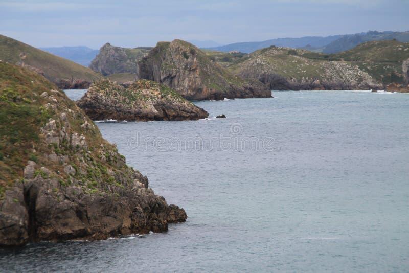 Costa de Llanes,Asturias ( Spain ). Coast of Llanes between the peninsula of Borizo and the island of Almenada, or Poo, with the island of Arnielles or stock image
