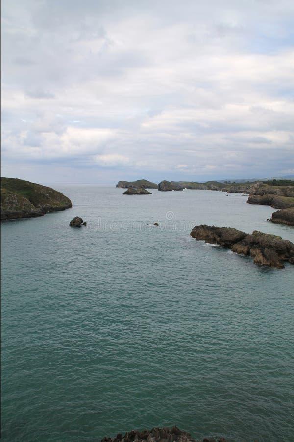 Costa de Llanes, Asturias ( Spain ). Coast of Llanes between the peninsula of Borizo and the island of Almenada, or Poo, with the island of Arnielles stock images