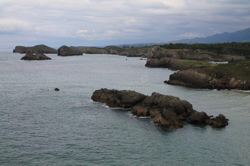 Costa de Llanes, Asturias ( Spain ). Coast of Llanes between the peninsula of Borizo and the island of Almenada, or Poo, with the island of Arnielles stock photos
