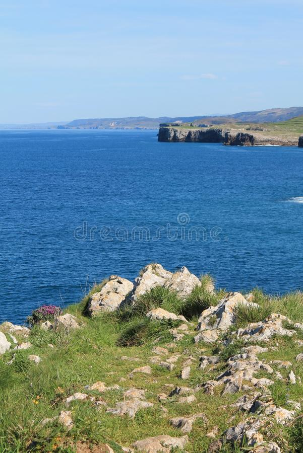 Costa de Llanes,Asturias, Spain. View of the coast and Cantabrian Sea, from the Paseo de San Pedro, at Llanes, Asturias, Spain royalty free stock image