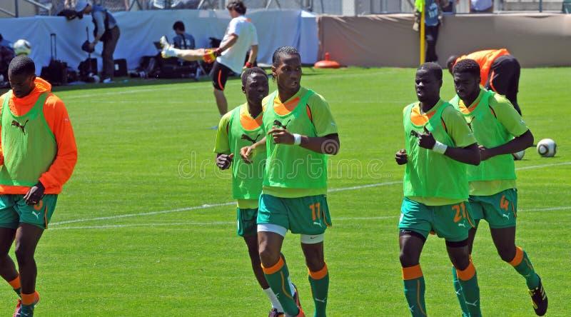 Costa de Marfil y partido de fútbol de Japón foto de archivo
