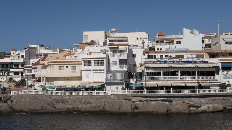 Costa La Caleta, Tenerife, Canary Islands, Spain - December 19, 2017. Cluster of houses and fish restaurants in the quaint village of La Caleta situated on the stock photo