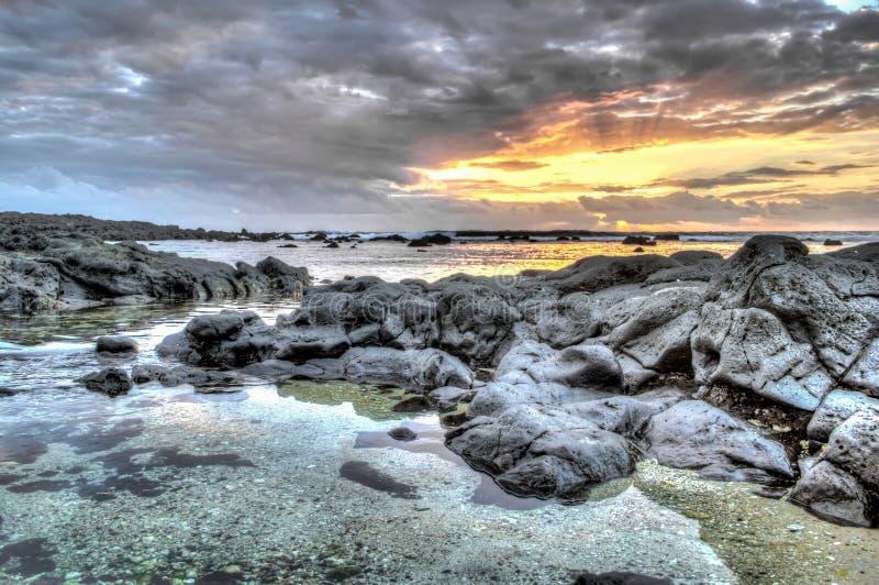Costa o île o mais ouest de la Réunion de Coucher de soleil imagens de stock royalty free