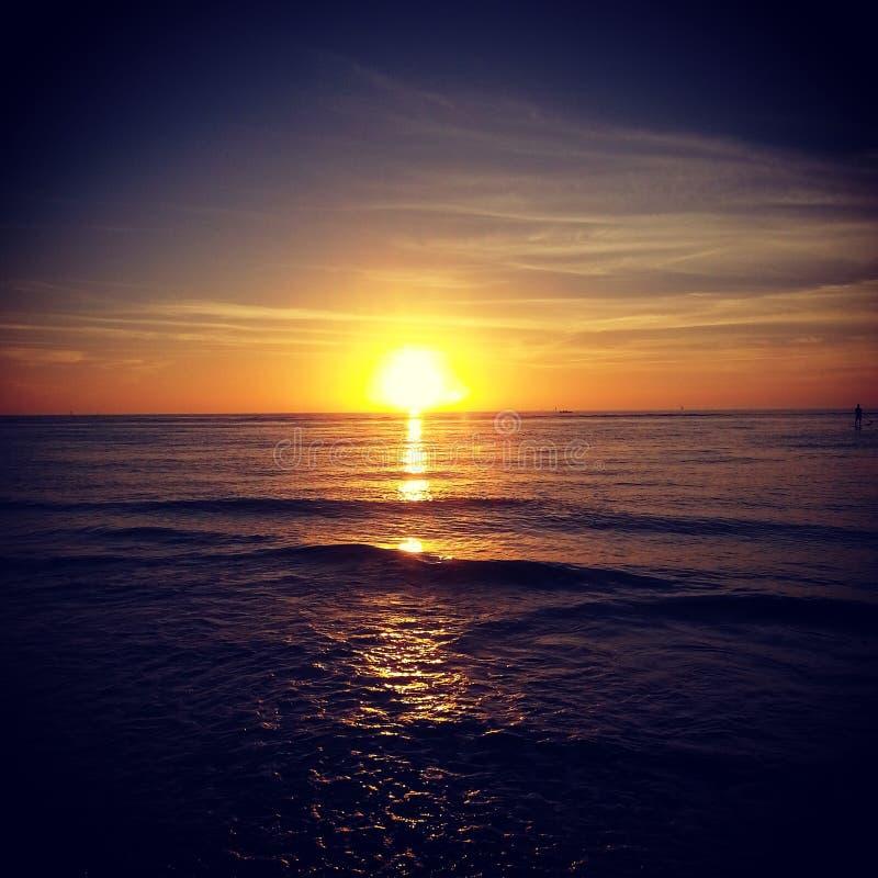 Costa oeste de la puesta del sol imagenes de archivo
