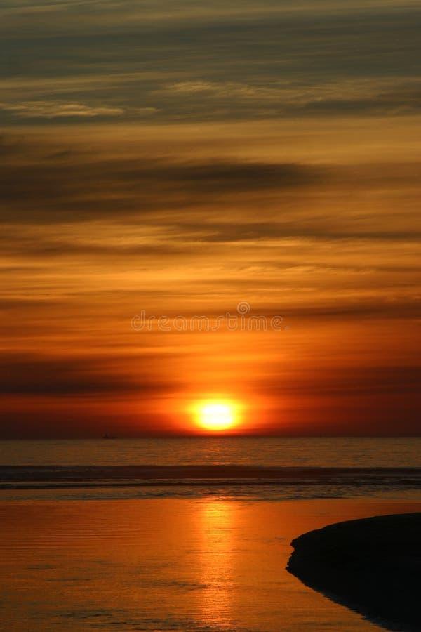 Costa oeste do por do sol fotografia de stock