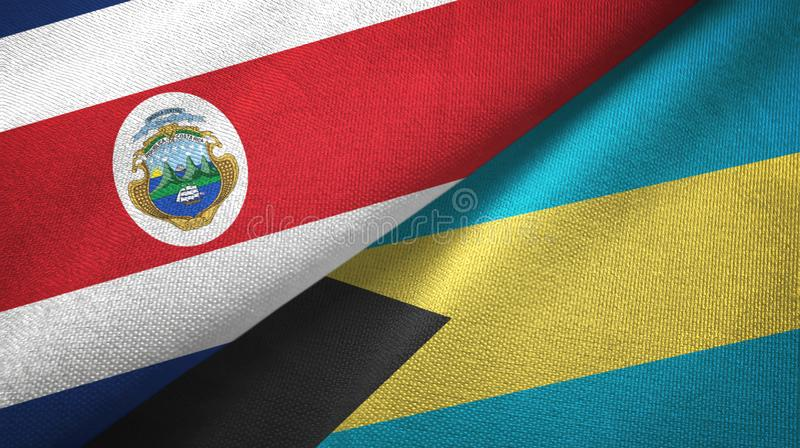 Costa Rica and Bahamas two flags textile cloth, fabric texture. Costa Rica and Bahamas two folded flags together stock illustration