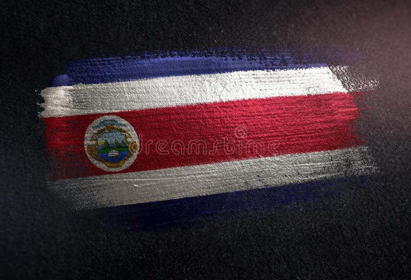 Costa Rica Flag Made of Metallic Brush Paint on Grunge Dark Wall royalty free stock images