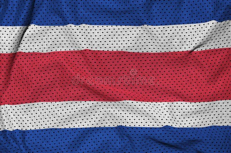 Costa Rica flagga som skrivs ut på ett fab ingrepp för polyesternylonsportswear royaltyfri illustrationer