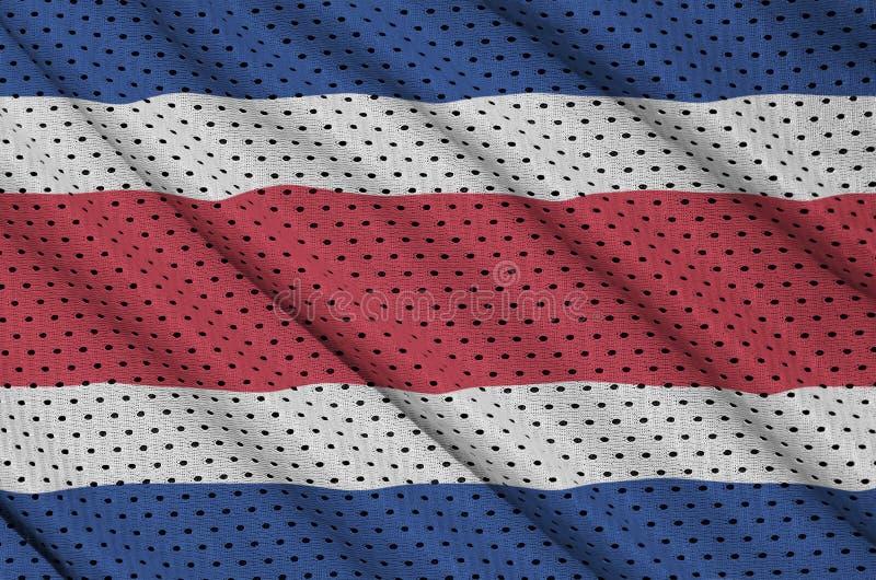 Costa Rica flagga som skrivs ut på ett fab ingrepp för polyesternylonsportswear royaltyfri fotografi