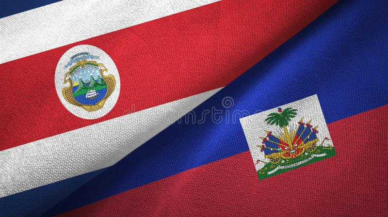Costa Rica and Haiti two flags textile cloth, fabric texture. Costa Rica and Haiti two folded flags together stock illustration