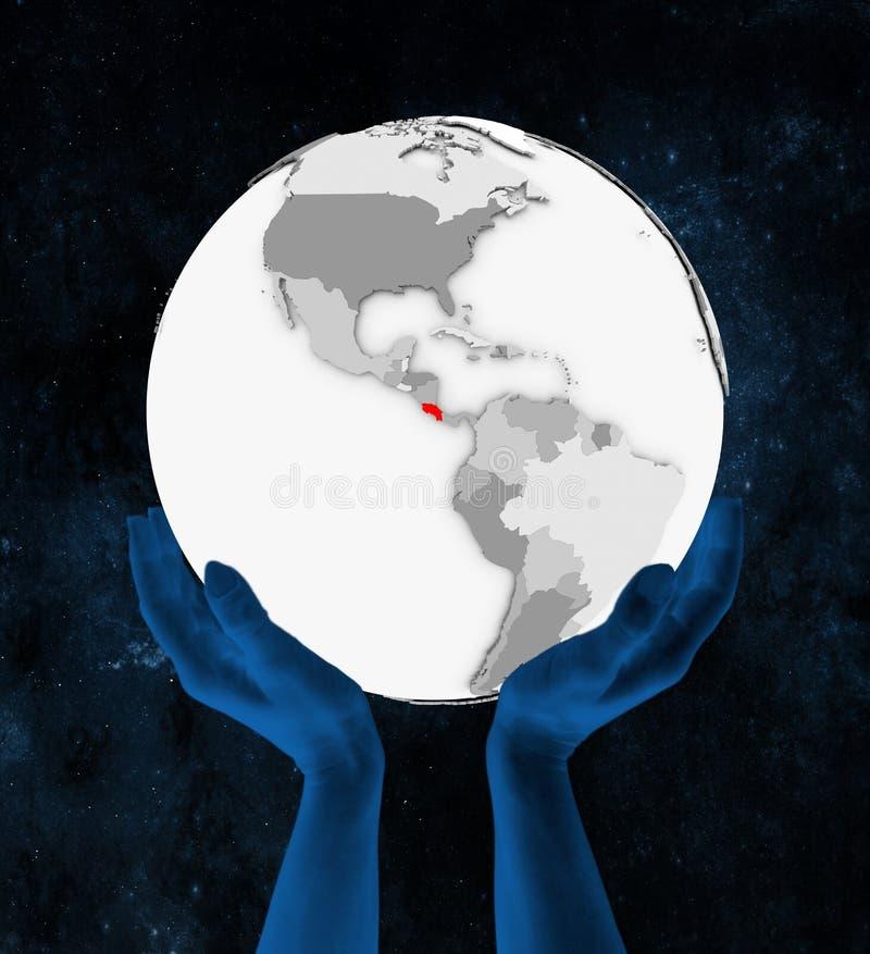 Costa Rica na białej kuli ziemskiej w rękach royalty ilustracja
