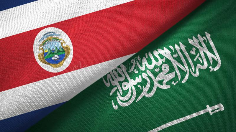 Costa Rica and Saudi Arabia flags textile cloth. Fabric texture. Text on saudi arabian flag means - There is no god but God, Muhammad is the Messenger of God royalty free illustration