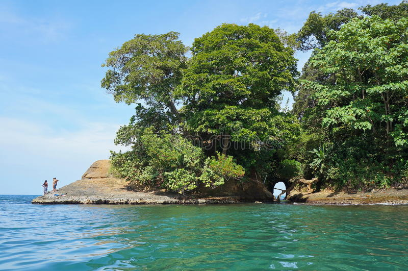 Costa Rica shore with natural cave in the rock royalty free stock photography