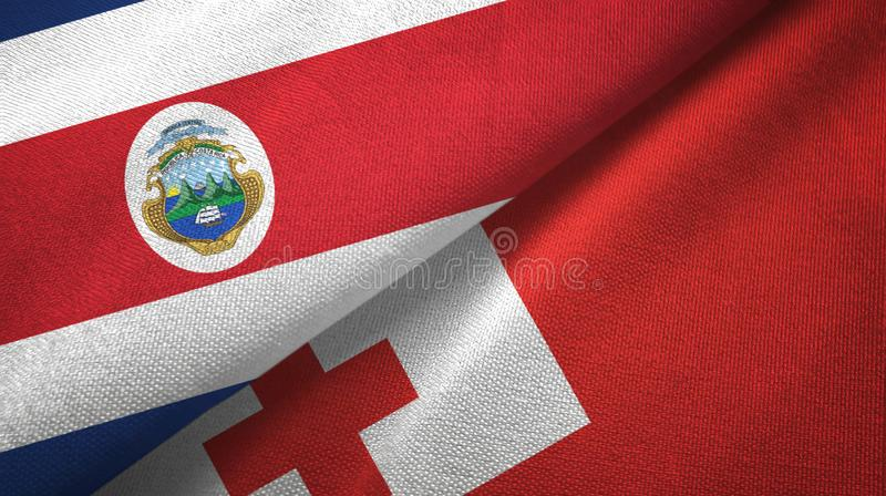 Costa Rica and Tonga two flags textile cloth, fabric texture. Costa Rica and Tonga two folded flags together stock illustration