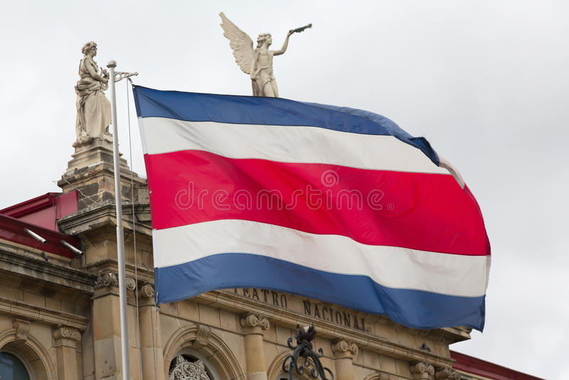 Costa Rican flag and National Theater stock photo