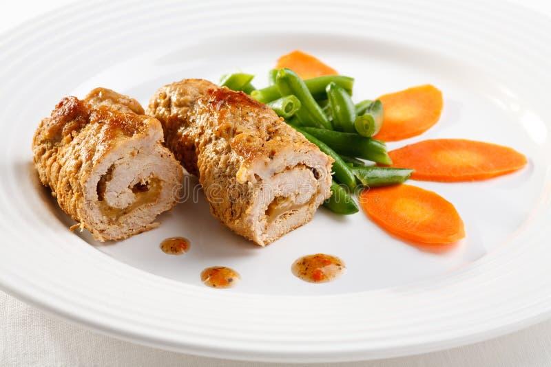 Costeleta e vegetais de carne de porco foto de stock royalty free