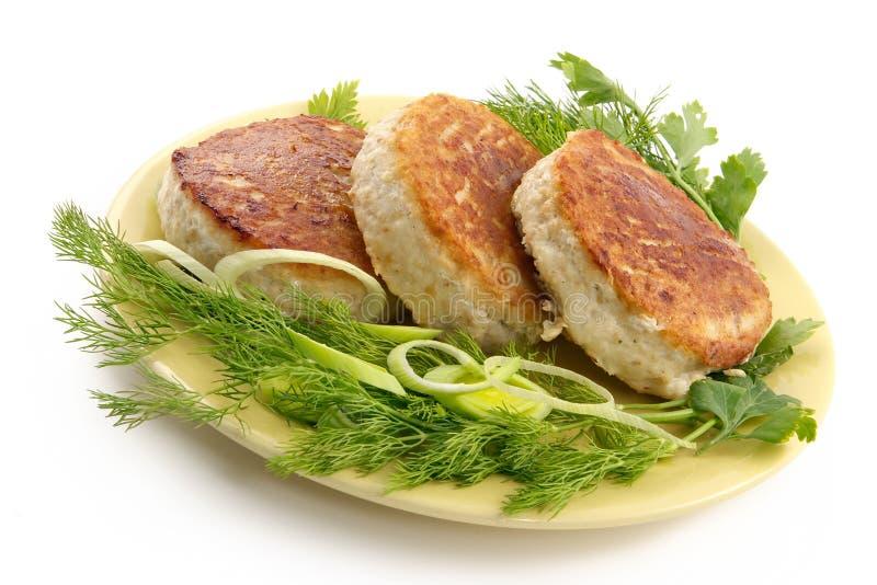 Costeletas de carne de porco suculentas com uma decoração dos verdes imagem de stock royalty free