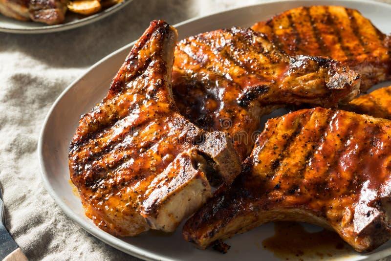 Costeletas de carne de porco caseiros do assado fotos de stock