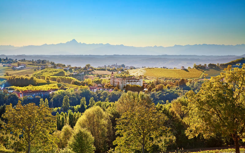 Costigliole d'Asti (Piedmont, Italy): landscape. With mountains on background stock photo