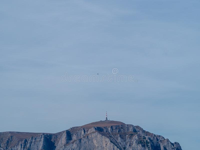 Costila peak in Bucegi mountains, Romania. Seen from the Baiu mountains. On top of the peak there is a radio and tv emission tower royalty free stock photos