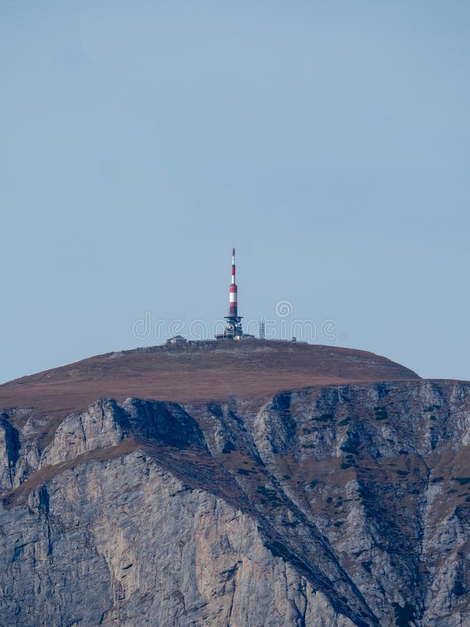 Costila peak in Bucegi mountains, Romania. Seen from the Baiu mountains. On top of the peak there is a radio and tv emission tower stock photography