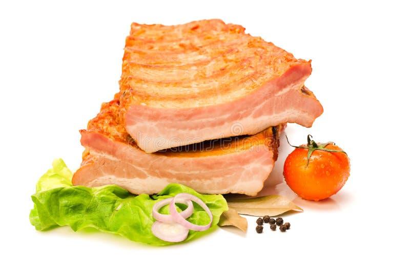 Costillas de cerdo sin procesar cortadas adentro a medias imágenes de archivo libres de regalías