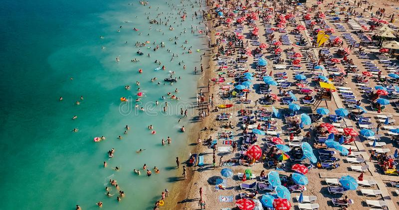 Aerial View From Flying Drone Of People Crowd Relaxing On Costinesti Beach In Romania stock photos