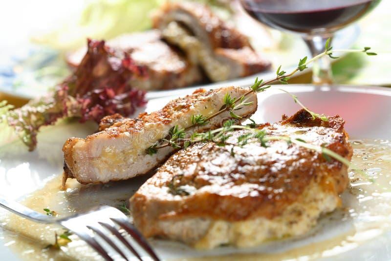 Costoleta da carne de porco com queijo fotos de stock royalty free