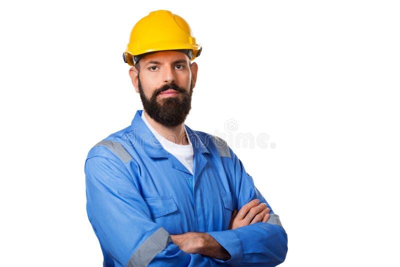 Costruttore in casco, in caporeparto o in riparatore nel casco Lavoratore barbuto dell'uomo con il casco in costruzione della bar immagini stock