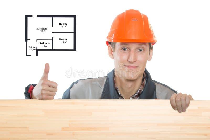 costruttore che tiene un segno per il vostro testo immagine stock
