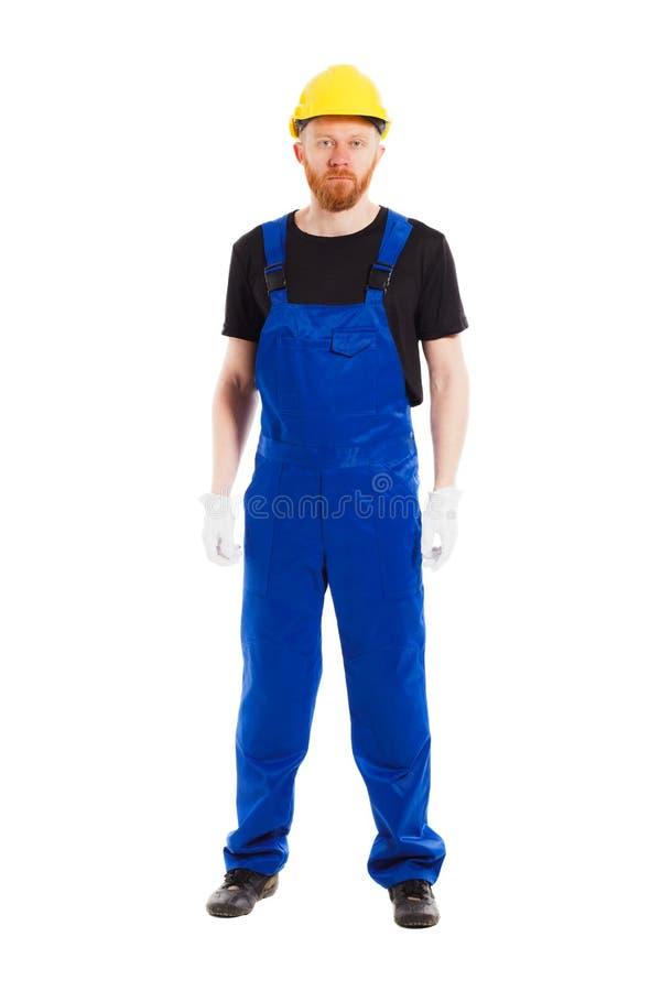 Costruttore dell'uomo nell'uniforme, isolata immagine stock libera da diritti
