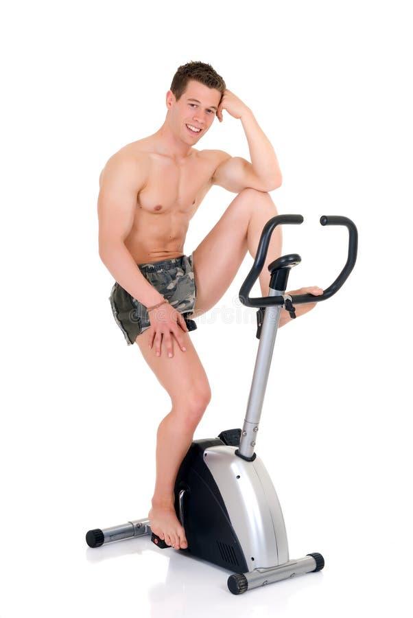 Costruttore di corpo, bici di forma fisica fotografie stock