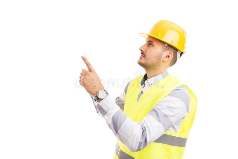 Costruttore o ingegnere dell'architetto che indica e che cerca immagine stock libera da diritti