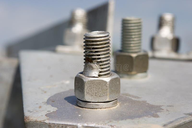 Costruzione del metallo con le viti fotografie stock