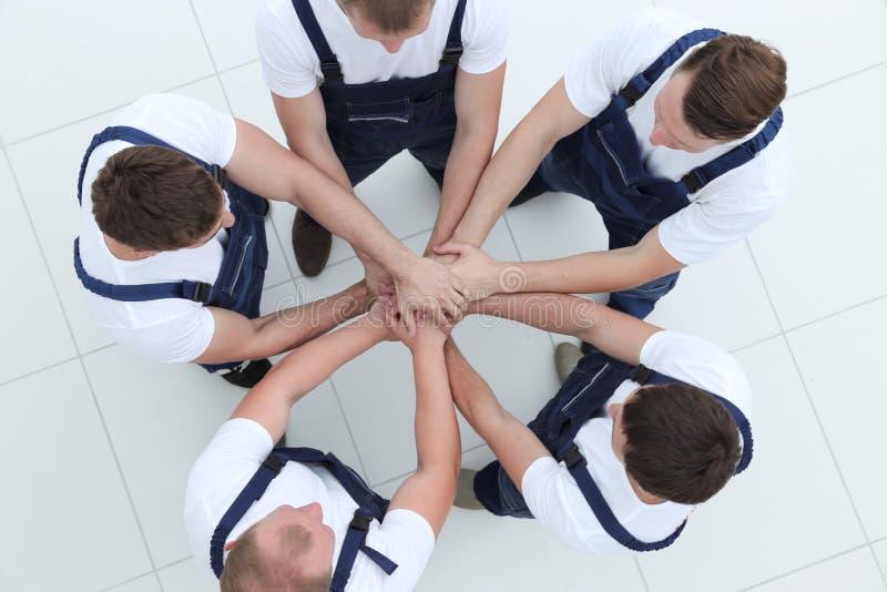 Costruzione, lavoro di squadra, associazione, gesto e la gente fotografia stock