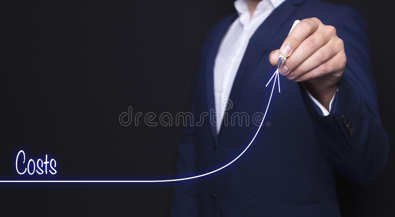 Costs and businessman stock image