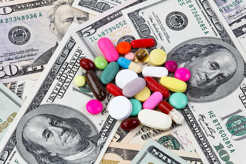 Costs for health, tablets and dollar bank notes stock photography