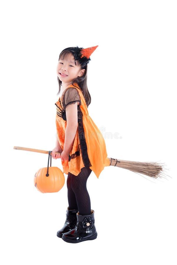 Costume d'uso di Halloween della strega della bambina fotografia stock