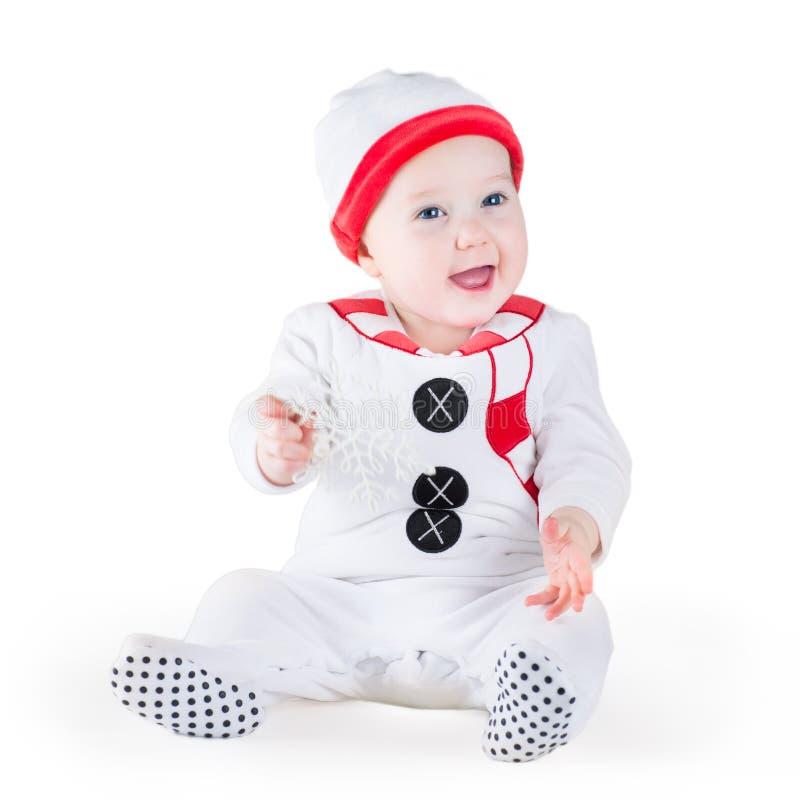 Costume de port d'homme de neige de Noël de bébé drôle image libre de droits
