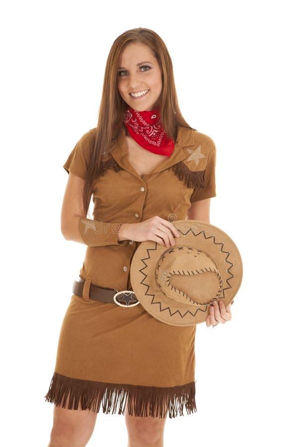 Costume del cappello della tenuta di sorriso fotografia stock libera da diritti