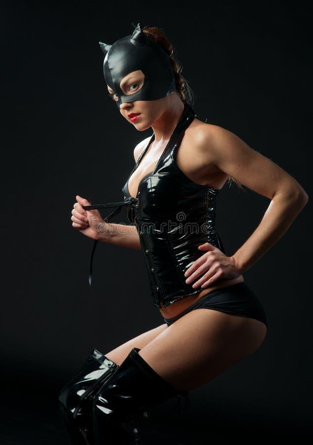 Costume del gatto del inlatex della donna fotografia stock